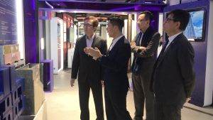 The USDEV, Mr LIU Chun-san (first left), and the PA, Mr Allen FUNG (second right), are briefed by the manager of the CITAC, Mr WAN Kai-hong (second left), on the benefits of the technology of Modular Integrated Construction (MiC)..