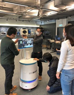 The project team of the technology company is installing and testing the mobile fever screening robot..