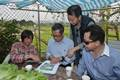 A farmer explains to Mr Chan (second left) the features of organic farming..