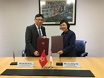 The Permanent Secretary for Development (Works), Mr Lam Sai-hung (left), and the Permanent Secretary of the Ministry of Finance of Singapore, Mrs Tan Ching-yee (right), sign a Memorandum of Understanding in Singapore today (July 30) to enhance collaboration in exchanging expertise and experience in infrastructure project management and delivery..