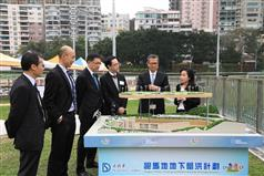 Accompanied by the Secretary for Development, Mr Eric Ma (third right), and the Director of Drainage Services, Mr Edwin Tong (third left), the Financial Secretary, Mr Paul Chan (second right), receives a briefing from an engineer of the Drainage Services Department on the Happy Valley Underground Stormwater Storage Scheme in Happy Valley today (March 16)..