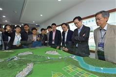 The Secretary for Development, Mr Eric Ma (second right), joins a duty visit to the Dongjiang River Basin by Legislative Council (LegCo) members today (April 15). Picture shows Mr Ma; the Permanent Secretary for Development (Works), Mr Hon Chi-keung (first right), and the  LegCo members viewing a model at the Taiyuan Pumping Station in Dongguan to learn about the Dongshen Water Supply Scheme..