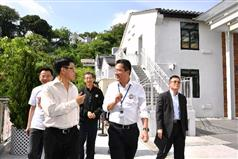 The Secretary for Development, Mr Michael Wong (front row, right), today (July 28) visits the Jao Tsung-I Academy and is briefed by the Chief Executive Officer of the Academy, Mr Mike Lai (front row, left), on the conservation, revitalisation and operation of the Grade 3 historic building..
