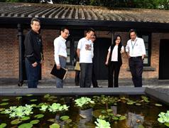 "The Secretary for Development, Mr Michael Wong (first right), today (July 28) visits the Jao Tsung-I Academy and is briefed on the lotus pond called ""Light and Shadow"" in the Academy. Looking on are the Director of Buildings, Mr Cheung Tin-cheung (third left); the Managing Director of the Urban Renewal Authority, Mr Wai Chi-sing (second left); and the Chairman of the Sham Shui Po District Council, Mr Ambrose Cheung (first left).."