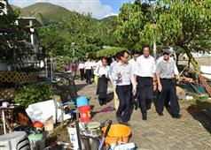 The Secretary for Development, Mr Michael Wong, visited Tai O this afternoon (August 24). Photo shows Mr Wong (front row centre) being briefed by the District Officer (Islands), Mr Anthony Li (front row left), on the condition of Tai O after the flood and follow-up work undertook by various government departments..