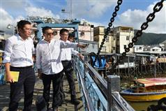 The Secretary for Development, Mr Michael Wong, visited Tai O this afternoon (August 24). Photo shows Mr Wong (left) being briefed by the Vice Chairman of the Islands District Council, Mr Randy Yu (second left), on the condition of Tai O after the flood. Looking on is the Director of Drainage Services, Mr Edwin Tong (third left)..