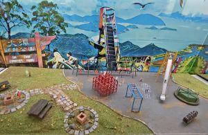 图示展城馆的「寻宝城市」模型,让访客欣赏到社区的建筑物、昔日游乐场的玩意等。.